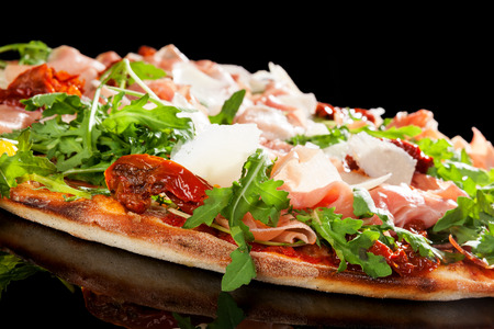 sundried: Delicious pizza with prosciutto ham, sundried tomatoes and fresh herbs.
