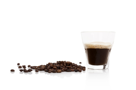 Delicious espresso with coffee beans isolated on white background.  Standard-Bild