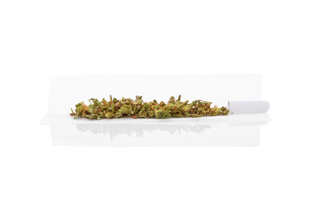 rolling paper: Marijuana bud and cigarette rolling paper isolated on white background Stock Photo