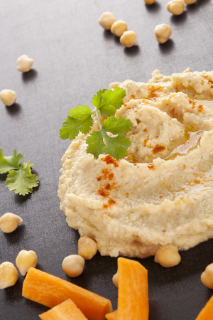 culinary arts: Fresh delicious hummus and fresh vegetables, chickpea and herbs Stock Photo