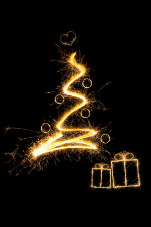 gifting: Merry christmas. Sparkling firework christmas tree with christmas presents. Minimal abstract artistic style.
