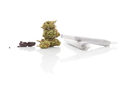 hach�s: Smoking marijuana. Cannabis abuse. Marijuana bud, hashish, and rolled joint isolated on white background. Foto de archivo