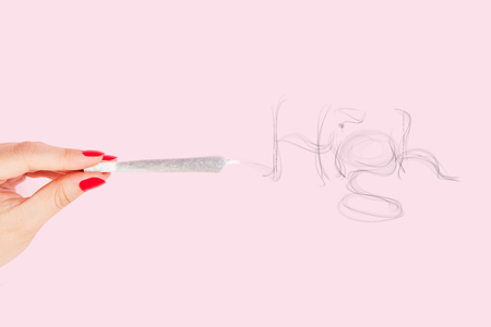 reefer: Female hand with red fingernails holding cannabis joint, smoke forming the word high isolated on pink background. Cannabis abuse. Stock Photo