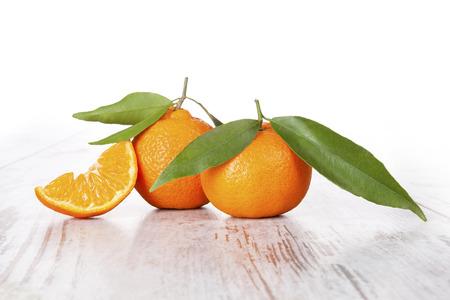 mandarine: Mandarine fruit on white wooden table. Provence style. Stock Photo
