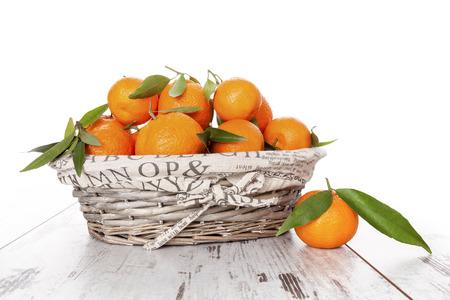 mandarine: Mandarine fruit in white wooden basket on white wooden table. Provence style.
