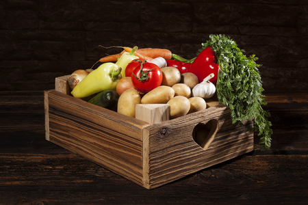 wooden crate: Organic seasonal vegetable in rustic wooden crate. Stock Photo