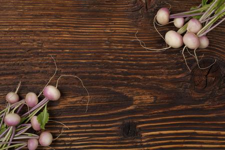 bundle: Ripe fresh radish bundle on wooden background.