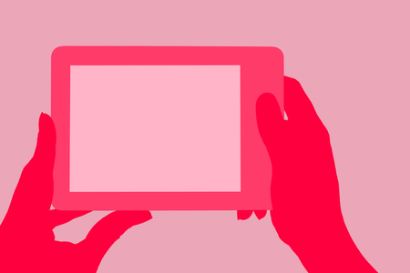 e reader: Female hand holding e reader with both hands isolated on pink background. Stock Photo