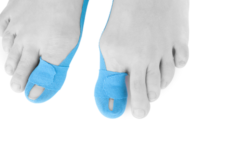 therapeutic: Therapeutic tape on female toe isolated on white background.