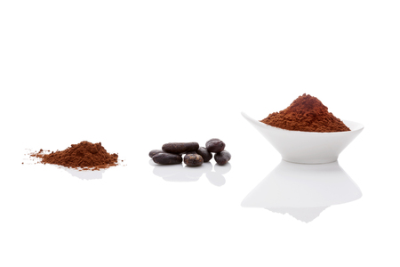 cocoa powder: Cocoa beans and cocoa powder on white background. Healthy superfood. Stock Photo