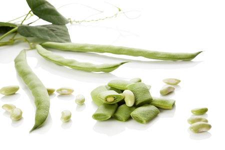 Green sliced beans isolated on white background. Healthy legume eating.