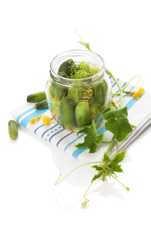 cucumis sativus: Pickles in glass jar isolated on white. Stock Photo