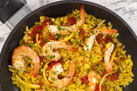 marisco: Delicious paella in panwith shrimps, from above. Stock Photo
