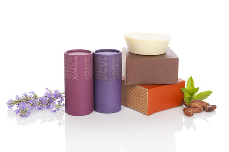Natural cosmetics. Cocoa and lavender cosmetics. Lavender and mint leaves, massage soap and deodorant isolated on white.