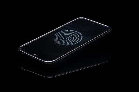 Fingerprint identification on cellphone. Smartphone isolated on blak background with fingerprint icon on screen. Stock fotó