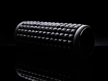 Foam roller on black background isolated.