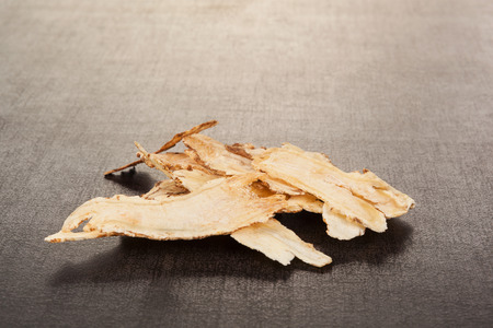 Angelica root used in chinese traditional herbal medicine over black background. TCM. Stock Photo