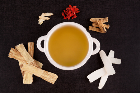 Different kind of Chinese herbal medicine for clear soup on black background. Imunity booster.