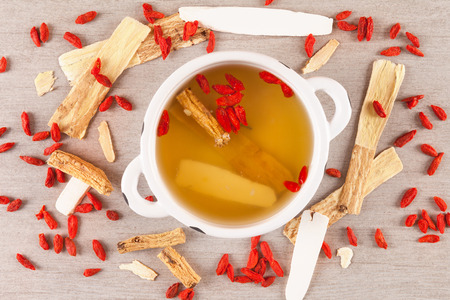 Different kind of Chinese herbal medicine for clear soup on gray background. Imunity booster. Archivio Fotografico