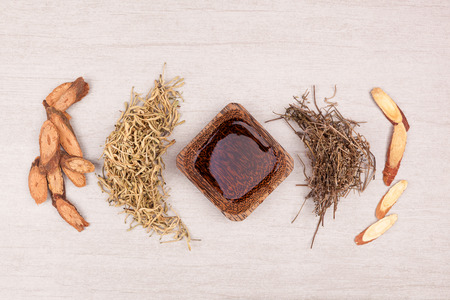 Traditional chinese medicine tea help to stop cough. TCM on gray background top view. Stock Photo