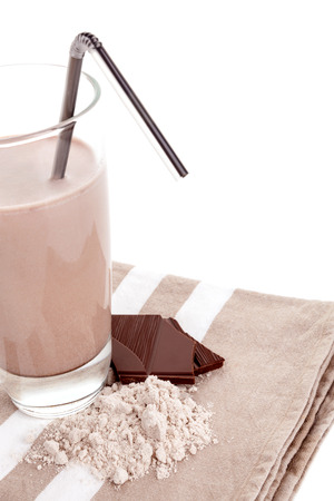 Chocolate protein powder in glass cup isolated on white background.