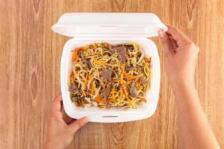 Delicious noodles in take away box from above.