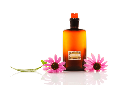 Echinacea flowers with extract in glass jar isolated on white background.