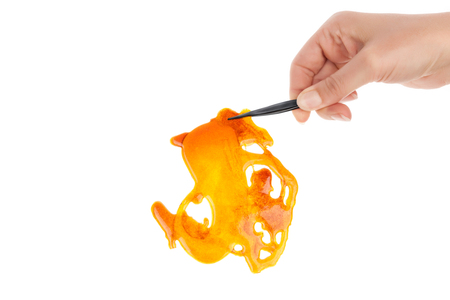 Marijuana concentrate shatter isolated on white background.