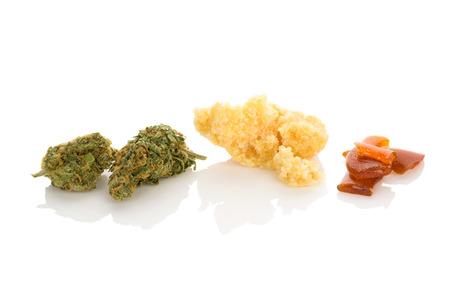 Cannabis bud, rosin, shatter. Marijuana concentrates on white background.