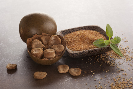 Luo Han Guo aka Monk fruit natural herbal remedy and sugar on brown background. Powerful healthy sweetener. Stock fotó