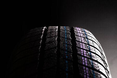 Detail of new winter wheel on black background. 版權商用圖片