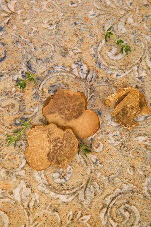 Raw white truffle mushrooms on the table top view. Culinary gastronomy.