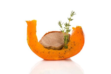 Roast duck with baked hokkaido pumkin and herbs isolated on white background. Culinary gourmet festive eating.