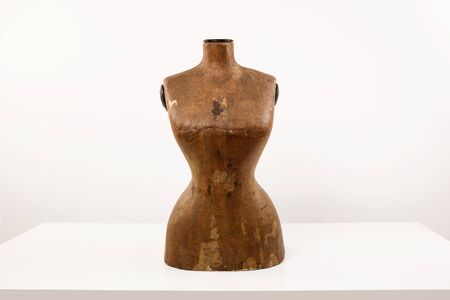 Antique wasp waist mannequin on white table. Stock Photo