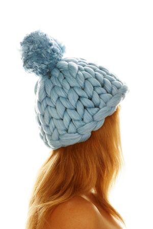 Young woman in merino cap. Handmade chunky knitting. Winter fashion lifestyle.