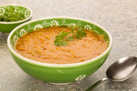 Vegan red lentil soup with coriander. Healthy legume food. Stock Photo