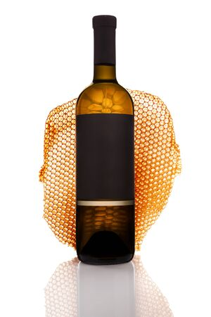 Bottle of white wine in the background with honeycomb isolated on white background. Stock fotó