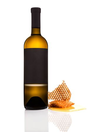 Bottle of white wine with honeycomb isolated on white background.