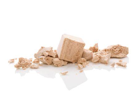Yeast blocks isolated on white background.