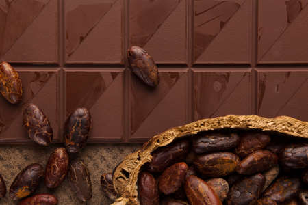 Delicious brown chocolate background. Dark mood picture. Stok Fotoğraf