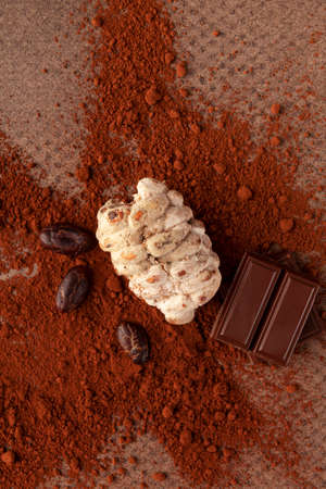 Cocoa beans, chocolate and powder on brown table. Stok Fotoğraf