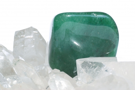 esoterics: Aventurine gem laid on quartz crystals