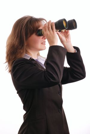 Attractive business woman with binoculars - isolated on white background