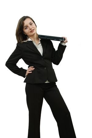 businesstrip: Business woman with portable computer on her shoulder Stock Photo