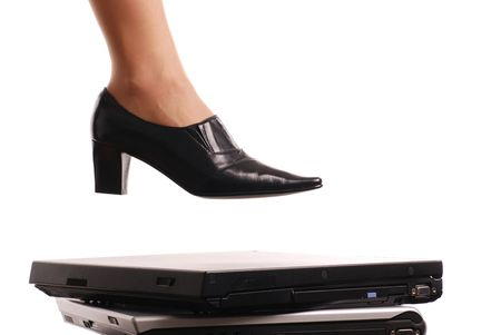 Leg of woman in elegant shoe stepping on computers - isolated on white background Stock Photo - 3671902