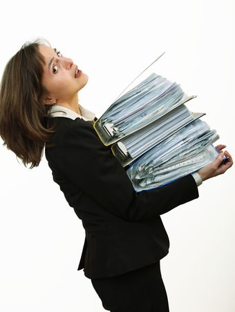 Business woman overloaded with heavy files                       Stock Photo