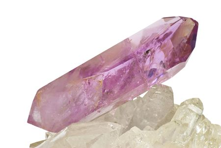Amethyst crystal laid on quartz - isolated on white