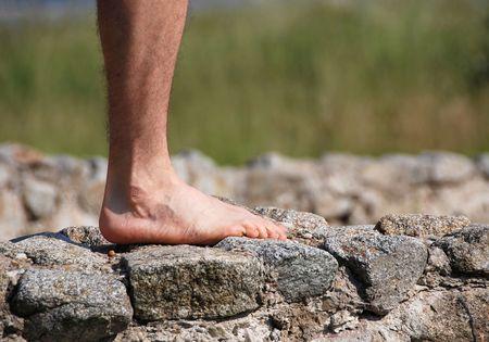 hairy legs: Leg of man on rock - stability