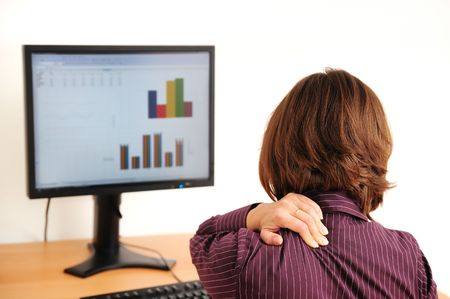 muscle tension tense: Business woman with neck pain sitting at computer
