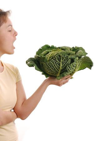 Woman wanting to eat fresh green savoy cabbage - isolated on white background                              photo